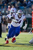 Buffalo Bills guard Richie Incognito (64) pulls while blocking for Mike Tolbert (35) during an NFL Wild-Card football game against the Jacksonville Jaguars, Sunday, January 7, 2018, in Jacksonville, Fla.  (Mike Janes Photography)