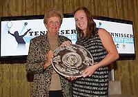 16-12-13, Netherlands, Amsterdam, Amstel Hotel, Tennisser van het jaar, Betty Stove gives the trophy of best player of the year to Kiki Bertens (R)<br /> Photo: Henk Koster