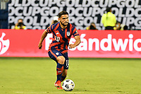 KANSAS CITY, KS - JULY 15: Christian Roldan #10 of the United States with the ball during a game between Martinique and USMNT at Children's Mercy Park on July 15, 2021 in Kansas City, Kansas.