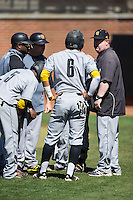 Kennesaw State Owls head coach Mike Sansing talks to his team during the game against the Winthrop Eagles at the Winthrop Ballpark on March 15, 2015 in Rock Hill, South Carolina.  The Eagles defeated the Owls 11-4.  (Brian Westerholt/Four Seam Images)