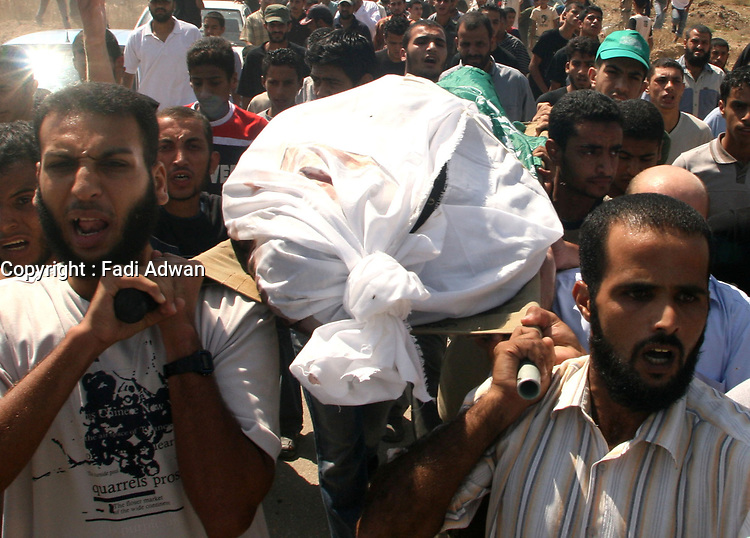"""Palestinians carry the body of Raad Abu Hjiar,  during his funeral in the Bureij refugee camp, central Gaza Strip, Thursday, Sept. 21, 2007. Israeli troops operating against rocket squads in Gaza .""""photo by Fday Adwan"""""""
