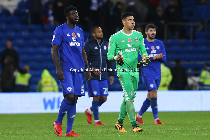 Bruno Ecuele Manga of Cardiff City and Neil Etheridge of Cardiff City after the final whistle of the Sky Bet Championship match between Cardiff City and Brentford at the Cardiff City Stadium, Wales, UK. Saturday 18 November 2017