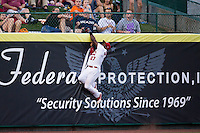 Starlin Rodriguez (27) of the Springfield Cardinals attempts to make a leaping catch during a game against the Northwest Arkansas Naturals at Hammons Field on August 23, 2013 in Springfield, Missouri. (David Welker/Four Seam Images)