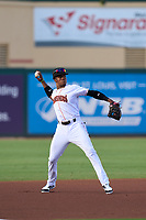 Jupiter Hammerheads third baseman Dalvy Rosario (7) throws to first base during a game against the Palm Beach Cardinals on May 11, 2021 at Roger Dean Chevrolet Stadium in Jupiter, Florida.  (Mike Janes/Four Seam Images)