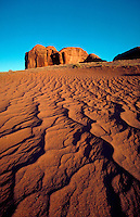Wide anlge view of sand patterns and rock formations at Monument Valley. Monument Valley National Park, Arizona.