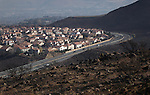 One man has died and an estimated 25 homes were destroyed by a 2,000-acre brush fire burned throught south Reno, Nev., on Friday, Nov. 18, 2011. (AP Photo/Cathleen Allison)