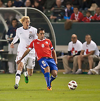 CARSON, CA – JANUARY 22: USA forward Eugene Starikov (21) and Chile midfielder Fernando Meneses (8) during the international friendly match between USA and Chile at the Home Depot Center, January 22, 2011 in Carson, California. Final score USA 1, Chile 1.