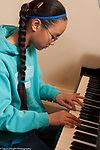 10 year old girl playing the piano