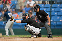 Great Falls Voyagers catcher Nate Nolan (18) sets a target as home plate umpire Phil Bando looks on during the game against the Helena Brewers at Centene Stadium on August 19, 2017 in Helena, Montana.  The Voyagers defeated the Brewers 8-7.  (Brian Westerholt/Four Seam Images)
