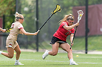 NEWTON, MA - MAY 14: Keyla Bay #6 of Fairfield University collects the ball as Caitlynn Mossman #7 of Boston College closes during NCAA Division I Women's Lacrosse Tournament first round game between Fairfield University and Boston College at Newton Campus Lacrosse Field on May 14, 2021 in Newton, Massachusetts.