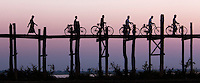 Bicycles on U Bein bridge at sunset, Amarapura, Myanmar