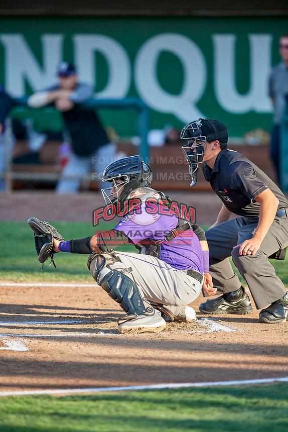 Javier Guevara (6) of the Grand Junction Rockies on defense with home plate umpire John Perez making the calls during a game against the Ogden Raptors at Lindquist Field on September 7, 2018 in Ogden, Utah. The Rockies defeated the Raptors 8-5. (Stephen Smith/Four Seam Images)