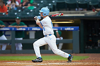 Tyler Lynn (14) of the North Carolina Tar Heels follows through on his swing against the Miami Hurricanes in the second semifinal of the 2017 ACC Baseball Championship at Louisville Slugger Field on May 27, 2017 in Louisville, Kentucky. The Tar Heels defeated the Hurricanes 12-4. (Brian Westerholt/Four Seam Images)