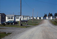 Gravel road through mobile home neighborhood