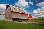 Bureau County, IL<br /> Weathered red barn under cumulus clouds