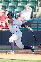 Miguel Andujar (5) of the Charleston RiverDogs follows through on his swing against the Hickory Crawdads at L.P. Frans Stadium on May 24, 2014 in Hickory, North Carolina.  The Crawdads defeated the RiverDogs 7-3.  (Brian Westerholt/Four Seam Images)