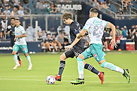 KANSAS CITY, KS - AUGUST 10: Wilson Harris #96 Sporting KC with the ball during a game between Club Leon and Sporting Kansas City at Children's Mercy Park on August 10, 2021 in Kansas City, Kansas.