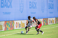 LAKE BUENA VISTA, FL - JULY 13: Richie Laryea #22 of Toronto FC and Joseph Mora #28 of DC United battle for the ball during a game between D.C. United and Toronto FC at Wide World of Sports on July 13, 2020 in Lake Buena Vista, Florida.