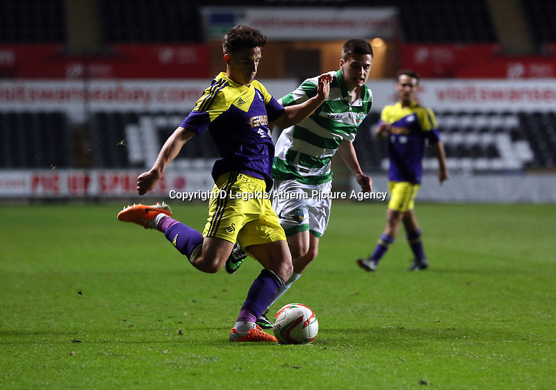 Thursday, 16 April 2014<br /> Pictured L-R: Liam Shephard of Swansea takes a cross, marked closely by a TNS player. <br /> Re: FAW Youth Cup Final, Swansea City FC v The New Saints FC at the Liberty Stadium, south Wales,