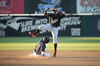Domingo Leyba (2) of the Visalia Rawhide throws to first base after getting the force out at second base during a game against the Lancaster JetHawks at The Hanger on July 6, 2016 in Lancaster, California. Lancaster defeated Visalia, 10-7. (Larry Goren/Four Seam Images)