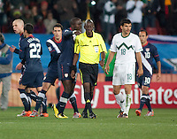 The USA's Jozy Altidore talks with Referee Koman Coulibaly (center) as Slovenia's  Aleksandar Radosavljevic (18) walks by) just after the end of the 2010 World Cup match between USA and Slovenia at Ellis Park Stadium in Johannesburg, South Africa on Friday, June 18, 2010.  The USA tied Slovenia 2-2.