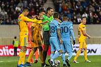 HARRISON, NJ - MARCH 11: Referee Juan Gabriel Calderon separates the two teams during a game between Tigres UANL and NYCFC at Red Bull Arena on March 11, 2020 in Harrison, New Jersey.