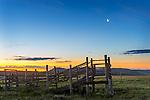 Teton County, Montana: Cattle pen under a quarter moon at dawn along the Front Range