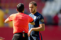 GUADALAJARA, MEXICO - MARCH 18: Hassani Dotson #18 of the United States and referee Said MARTINEZ exchange a few words during a game between Costa Rica and USMNT U-23 at Estadio Jalisco on March 18, 2021 in Guadalajara, Mexico.