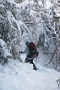 Appalachian Trail - Snowshoer on the Carter-Moriah Trail in winter conditions near Middle Carter Mountain in the White Mountains, New Hampshire USA.