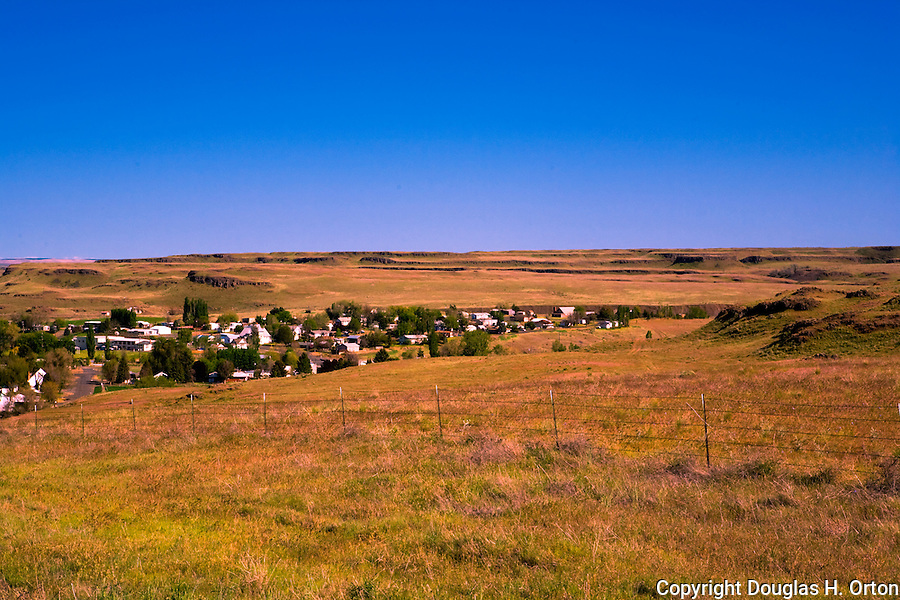 The town of Washtucna marks the turn off from the Palouse Scenic Byway where SR 261 departs for famous Palouse Falls, Washington. Washtucna Coulee in the background.  The Palouse is known as the heart of wheat farming in the United States is also famous for its rolling scenery along the Palouse Scenic Byway.