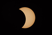The Moon continues to pass the Sun's disk in the second partial eclipse phase of the Great American Eclipse on August 21, 2017.  Sunspots are visible on the sun's surface.