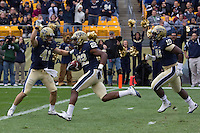 Pitt defensive back Antwuan Reed (22) scores on a 10 yard return of a blocked punt.The Utah Utes defeated the Pitt Panthers 26-14 at Heinz Field, Pittsburgh, Pennsylvania on October 15, 2011.