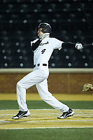 D.J. Poteet (4) of the Wake Forest Demon Deacons follows through on his swing against the Florida State Seminoles at David F. Couch Ballpark on March 9, 2018 in  Winston-Salem, North Carolina.  The Seminoles defeated the Demon Deacons 7-3.  (Brian Westerholt/Four Seam Images)
