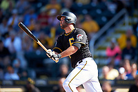Pittsburgh Pirates catcher Jacob Stallings (58) follows through on a swing during a Spring Training game against the Tampa Bay Rays on March 10, 2017 at LECOM Park in Bradenton, Florida.  Pittsburgh defeated New York 4-1.  (Mike Janes/Four Seam Images)