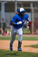 Toronto Blue Jays Dasan Brown (14) runs to first base during an exhibition game against the Canada Junior National Team on March 8, 2020 at Baseball City in St. Petersburg, Florida.  (Mike Janes/Four Seam Images)