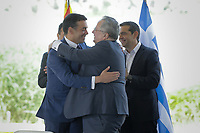 Pictured: (L-R) Nikola Dimitrov Minister of Foreign Affairs of FYROM embraces Nikos Kotzias at Prespa Lake in northern Greece. Sunday 17 June 2018<br /> Re: Greece and the Former Yugoslav Republic Of Macedonia (FYROM) have signed a deal that aims to settle a decades-long dispute over the country's name.<br /> Under the agreement, Greece's neighbour will be known as North Macedonia.<br /> Heated rows over Macedonia's name have been going on since the break-up of the former Yugoslavia, of which it was a part, and have held up Macedonia's entry to Nato and the EU.<br /> Greece has long argued that by using the name Macedonia, its neighbour was implying it had a claim on the northern Greek province also called Macedonia.<br /> The two countries' leaders, Mr Tsipras and his Macedonian counterpart Zoran Zaev announced the deal on Tuesday and have pressed ahead despite protests.<br /> The two countries' foreign ministers signed the deal on Lake Prespa on Greece's northern border on Sunday.<br /> The agreement still needs to be approved by both parliaments and by a referendum in Macedonia.