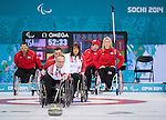 Sochi, RUSSIA - Mar 10 2014 -  Dennis Thiessen makes a shot as Ina Forrest looks on during Canada vs USA in Wheelchair Curling round robin play at the 2014 Paralympic Winter Games in Sochi, Russia.  (Photo: Matthew Murnaghan/Canadian Paralympic Committee)