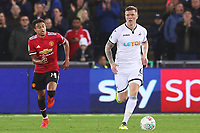 Alfie Mawson of Swansea City is marked by Jesse Lingard of Manchester United during the Carabao Cup Fourth Round match between Swansea City and Manchester United at the Liberty Stadium, Swansea, Wales, UK. Tuesday 24 October 2017