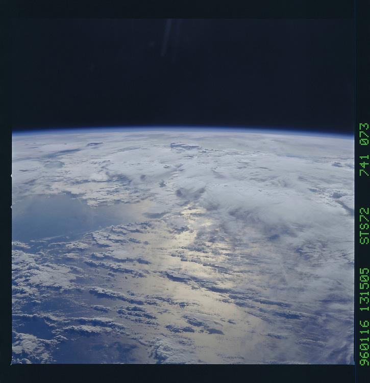 John Angerson. STS-72 Book.<br /> Public Domain Image.<br /> NASA images Courtesy National Archives - Record Group number: 255-STS-STS072<br /> Description: Earth observations taken from shuttle orbiter Endeavour during STS-72 mission.<br /> <br /> Subject Terms: STS-72, ENDEAVOUR (ORBITER), EARTH OBSERVATIONS (FROM SPACE), EARTH LIMB<br /> <br /> Date Taken: 1/16/1996<br /> <br /> Categories: Earth Observations<br /> <br /> Interior_Exterior: Exterior<br /> <br /> Ground_Orbit: On-orbit<br /> <br /> Original: Film - 70MM CT<br /> <br /> Preservation File Format: TIFF<br /> <br /> geon: PACIFIC OCEAN<br /> <br /> feat: PAN-CLOUDS, SUNGLINT<br /> <br /> tilt: High Oblique<br /> <br /> cldp: 65<br /> <br /> nlat: 5.3<br /> <br /> nlon: -87.6<br /> <br /> azi: 114<br /> <br /> alt: 166<br /> <br /> elev: 15