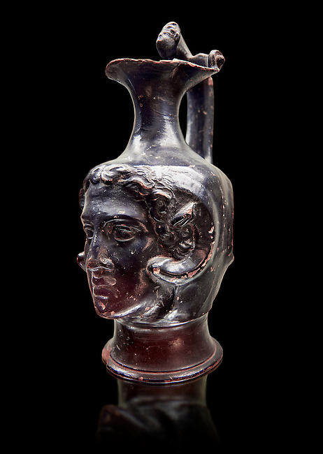 Etruscan bucchero jug with a face,  National Archaeological Museum Florence, Italy , black background
