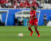 GRENOBLE, FRANCE - JUNE 15: Ashley Lawrence #10 of the Canadian National Team brings the ball forward during a game between New Zealand and Canada at Stade des Alpes on June 15, 2019 in Grenoble, France.