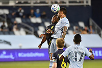 KANSAS CITY, KS - OCTOBER 11: Khiry Shelton #11 of Sporting Kansas City goes up for a header with Tah Brian Anunga #27 of Nashville SC during a game between Nashville SC and Sporting Kansas City at Children's Mercy Park on October 11, 2020 in Kansas City, Kansas.