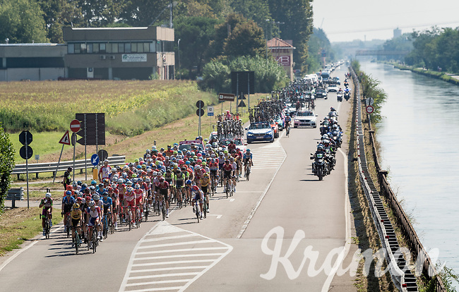 Peloton racing out of Milano<br /> <br /> 'La Primavera' (Spring) in summer!<br /> 111st Milano-Sanremo 2020 (1.UWT)<br /> 1 day race from Milano to Sanremo (305km)<br /> <br /> the postponed edition > exceptionally held in summer because of the Covid-19 pandemic calendar reshuffle