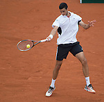 Victor Hanescu (ROU) loses to Gael Monfils (FRA) 6-2, 4-6, 6-4, 6-2 at  Roland Garros being played at Stade Roland Garros in Paris, France on May 27, 2014