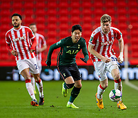 23rd December 2020; Bet365 Stadium, Stoke, Staffordshire, England; English Football League Cup Football, Carabao Cup, Stoke City versus Tottenham Hotspur; Nathan Collins of Stoke City under pressure from Son Heung-min of Tottenham Hotspur