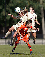 Boston College midfielder Kate McCarthy (21), Boston College midfielder Patrice Vettori (18), and University of Miami forward Kate Howarth (1) battle for head ball. .After two overtime periods, Boston College (gold) tied University of Miami (orange), 0-0, at Newton Campus Field, October 21, 2012.