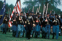 Reenactment of American Civil War. Union soldiers march in formation.