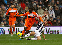 Pictured: Nathan Dyer of Swansea (L) tackled by Nicky Shorey of West Bromwich (R). Saturday, 04 February 2012<br /> Re: Premier League football, West Bromwich Albion v Swansea City FC v at the Hawthorns Stadium, Birmingham, West Midlands.