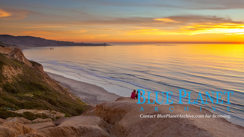Sunset falls upon Torrey Pines State Reserve, viewed from the Torrey Pines glider port.  La Jolla, Scripps Institution of Oceanography and Scripps Pier are seen in the distance.