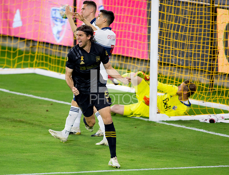 LOS ANGELES, CA - SEPTEMBER 23: Dejan Jakovic #5 of LAFC scores his goal and celebrates during a game between Vancouver Whitecaps and Los Angeles FC at Banc of California Stadium on September 23, 2020 in Los Angeles, California.